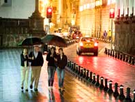photo of friends walking in Quito in the evening